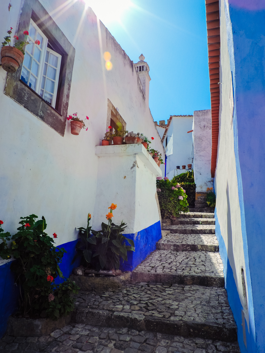 Sunshine in a colorful Obidos alleyway