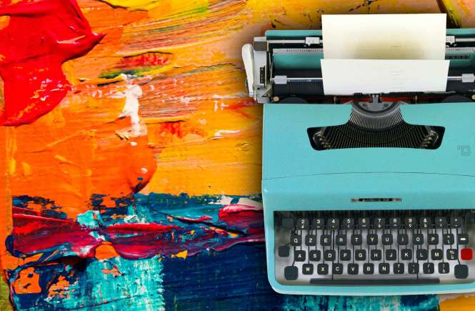 Turquoise typewriter on top of colorful paint
