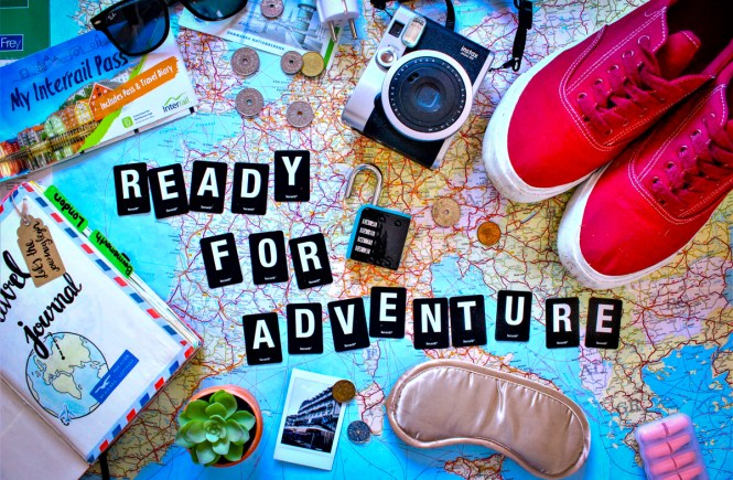 Travel supplies spread out across a world map