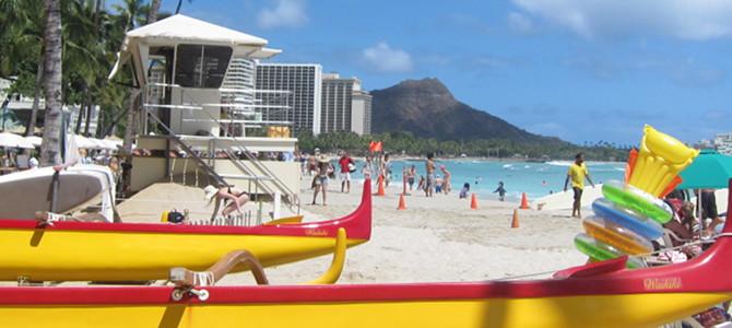 Waikiki Beach boasts white sands and blue seas.