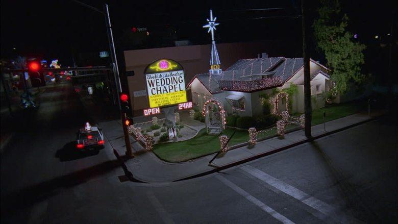 735699238-intolerable-cruelty-film-wedding-chapel-stop-sign-chain-of-light