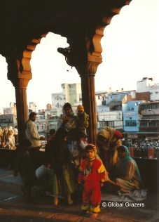 A family enjoys iftar after the Friday prayer at Jama Masjid Mosque. Old Delhi, India