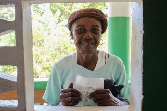 Patient at pharmacy window. Global Health Teams - Haiti Medical Volunteer