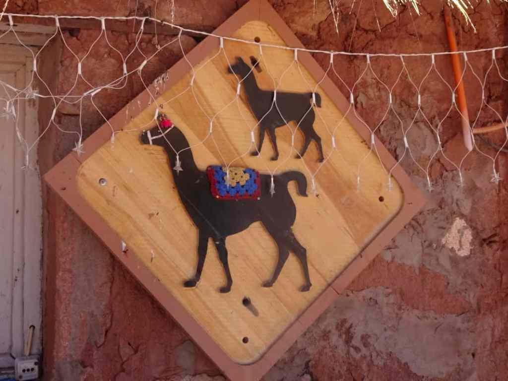 Llama sign at Machuca - Aacama