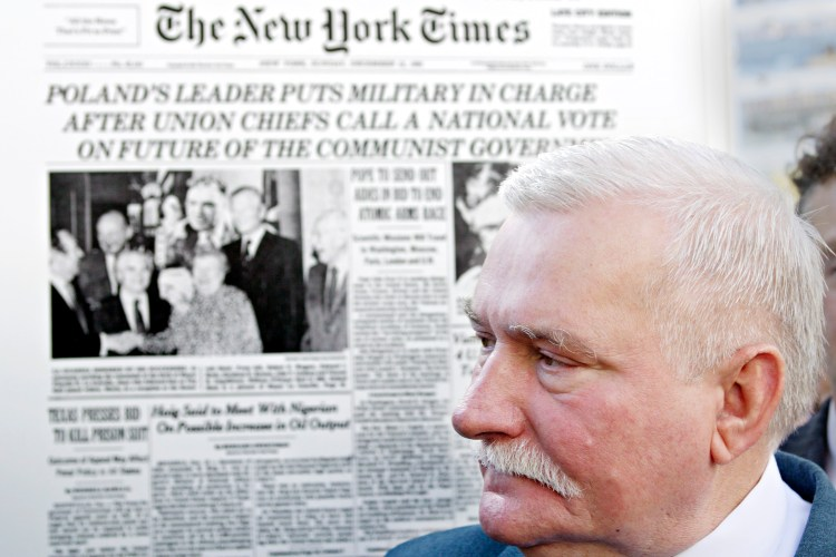 Nobel Peace Prize recipient and former President of Poland Lech Walesa stands in front of an old New York Times front page during a press conference Sept 28, 2005.  (AP Photo/Adam Rountree)