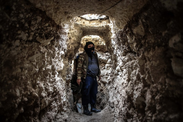 An Al-Qaida fighter inside a tunnel near the Air Force Intelligence headquarters in Aleppo, during fighting with pro-Assad militias (Ibrahim Khader)