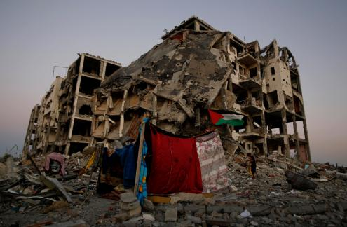 A makeshift tent stands near to the destruction of buildings at a residential neighborhood, in Beit Lahiya, northern Gaza Strip, Aug. 7, 2014.  (AP Photo/Hatem Moussa)