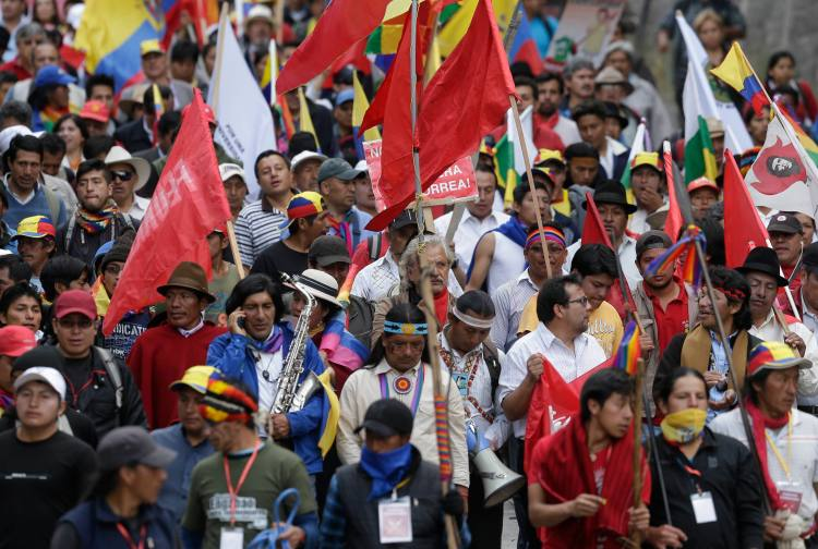 Indian protesters arrive to Quito during a march called by the Confederation of Indian Nationalities of Ecuador, in Quito, Ecuador, Aug. 12, 2015. Picq was arrested the next day at a protest. (AP Photo/Dolores Ochoa)