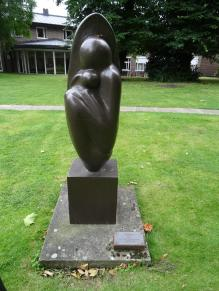 "British artist Naomi Blake (born c. 1924/1927?) created this embryonic ""Genesis"" sculpture. She is a survivor of the Holocaust at Auschwitz."