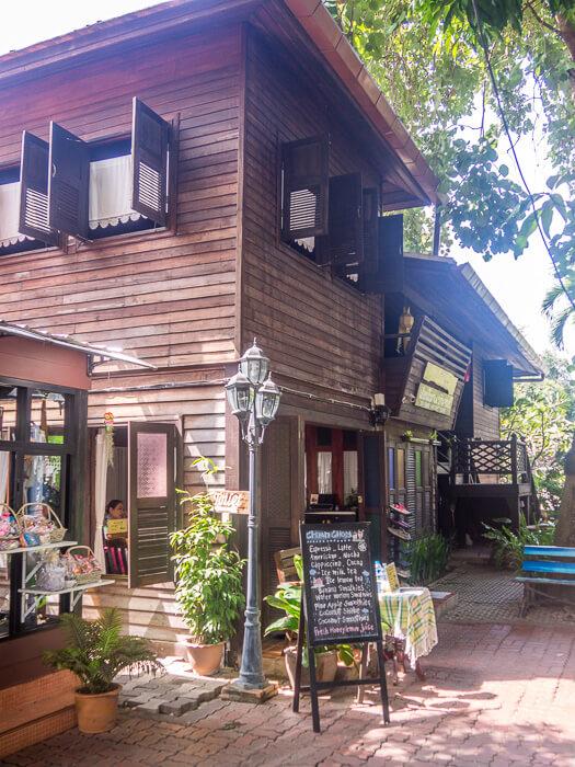 wooden building in serene courtyard thailand