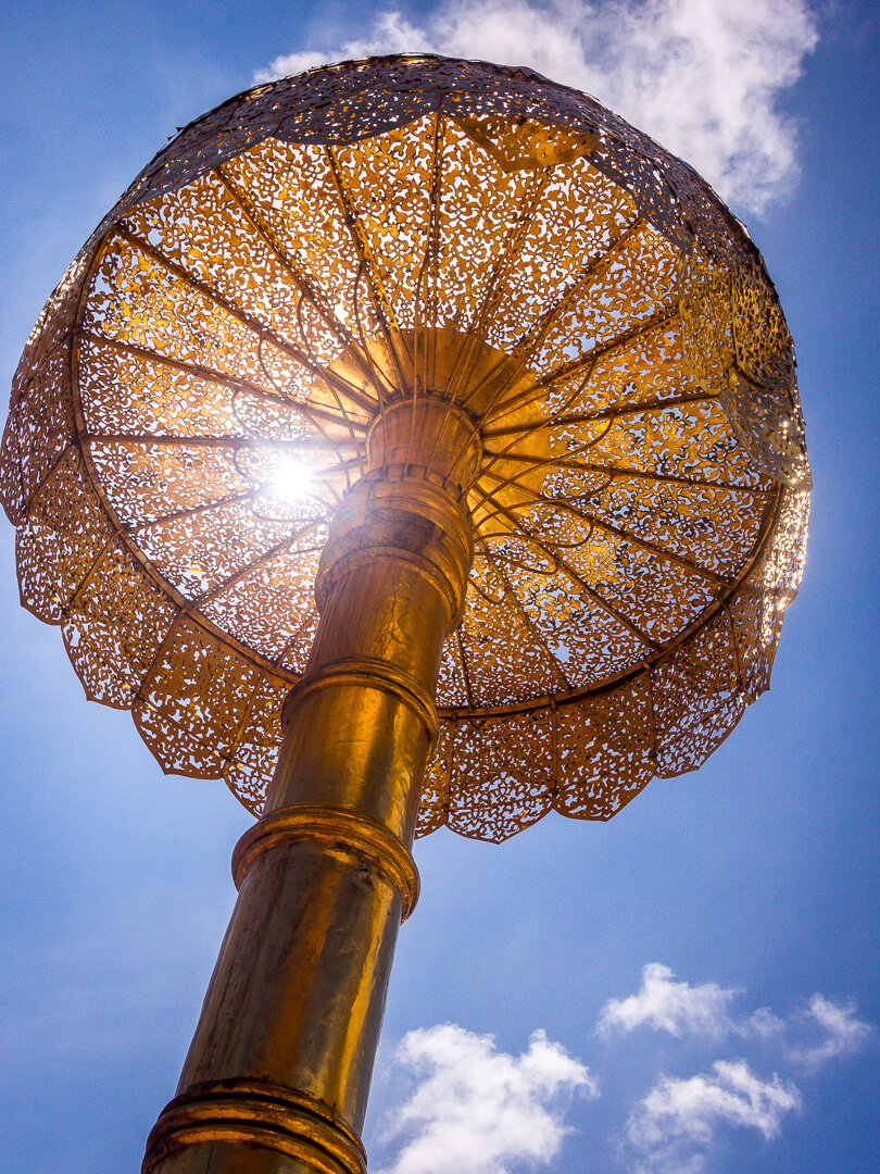 golden umbrellas in northern thailands temples