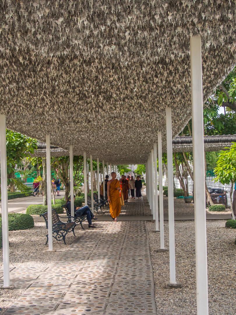 monk at white temple chiang rai thailand