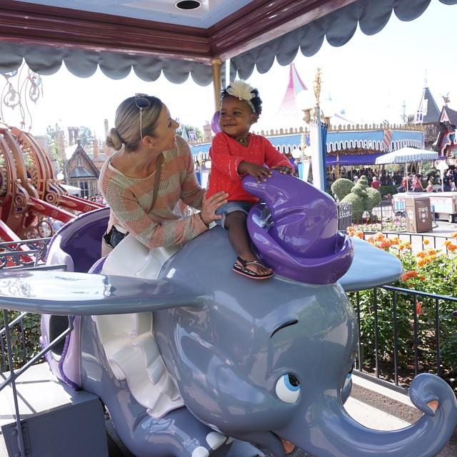 Transracial adoptive mom and daughter on Dumbo ride at Disneyland