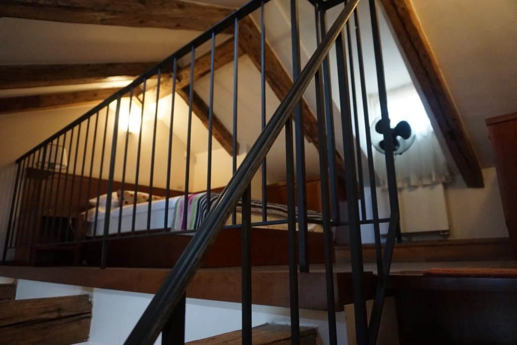 Headed upstairs to bedroom The Nicholas Hotel Residence in Prague. A review by Global Munchkins