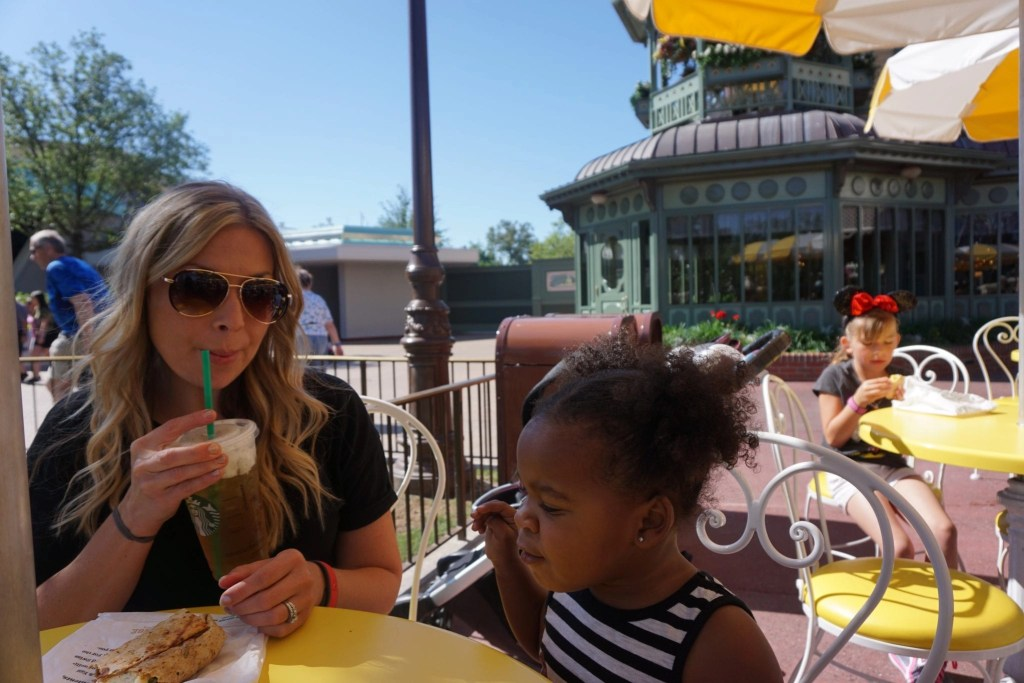 White mother having lunch with her adopted black daughter at Magic Kingdom park | Global Munchkins