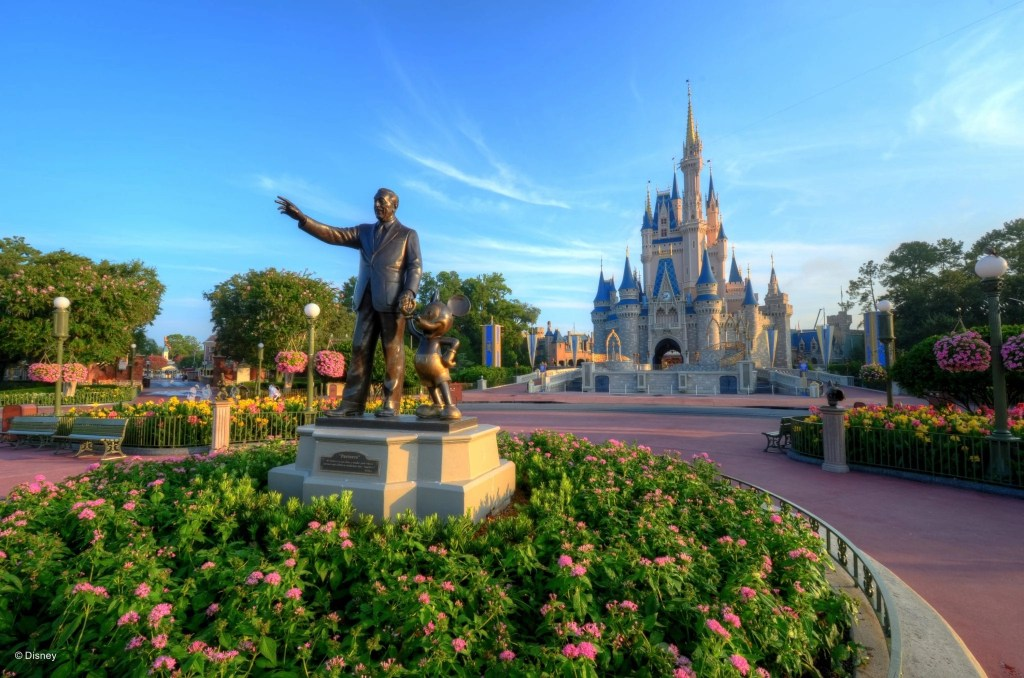 Gorgeous shot Walt Disney Statue with Cinderella's castle in the background | Global Munchkins