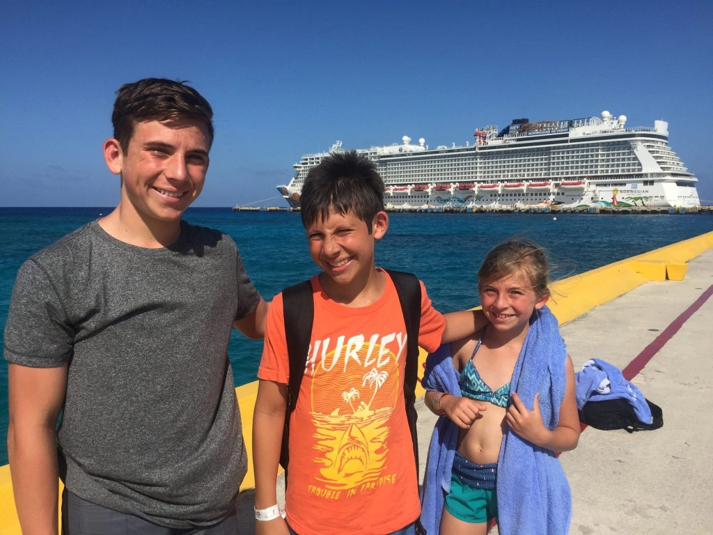 Family at port in Costa Maya with Cruise Ship behind
