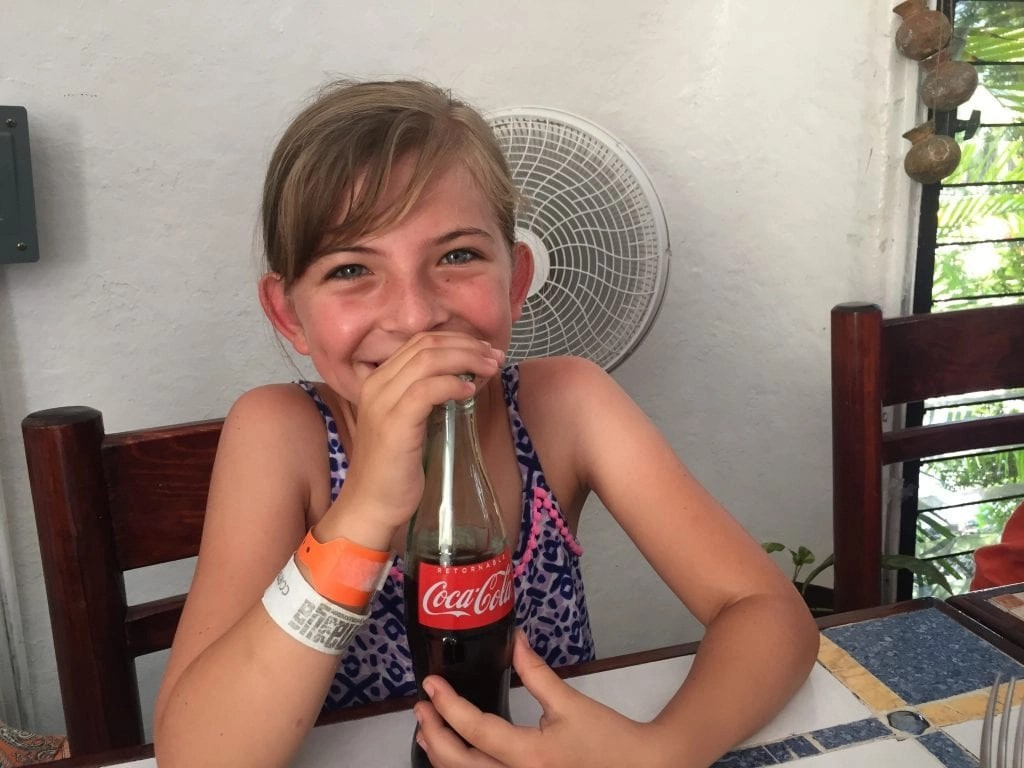 Classic coke and a little girl in Mexico