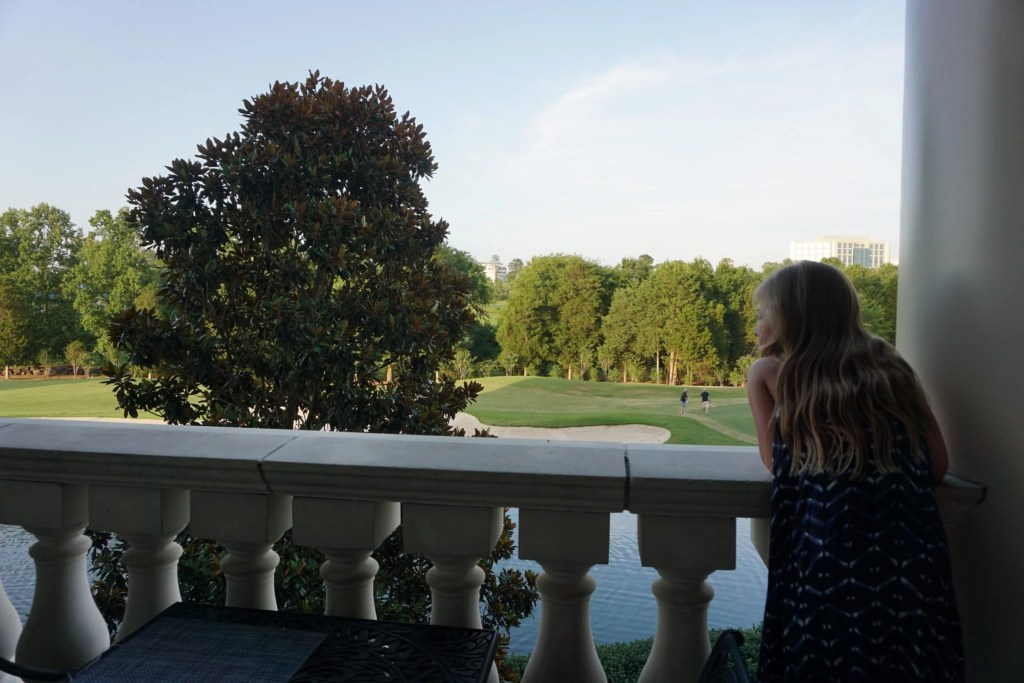 a little girl soaking up the views at the Ballantyne Hotel in North Carolina | Global Munchkins