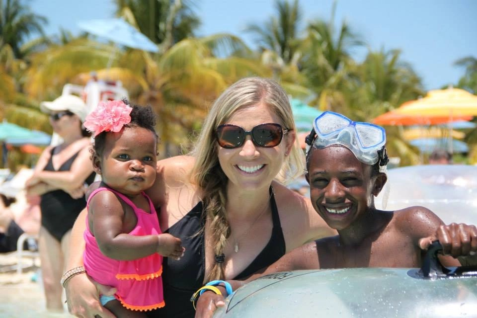 Mom with adopted son and daughter in water at Castaway Cay Disney Cruise Line's Private Island | Global Munchkins