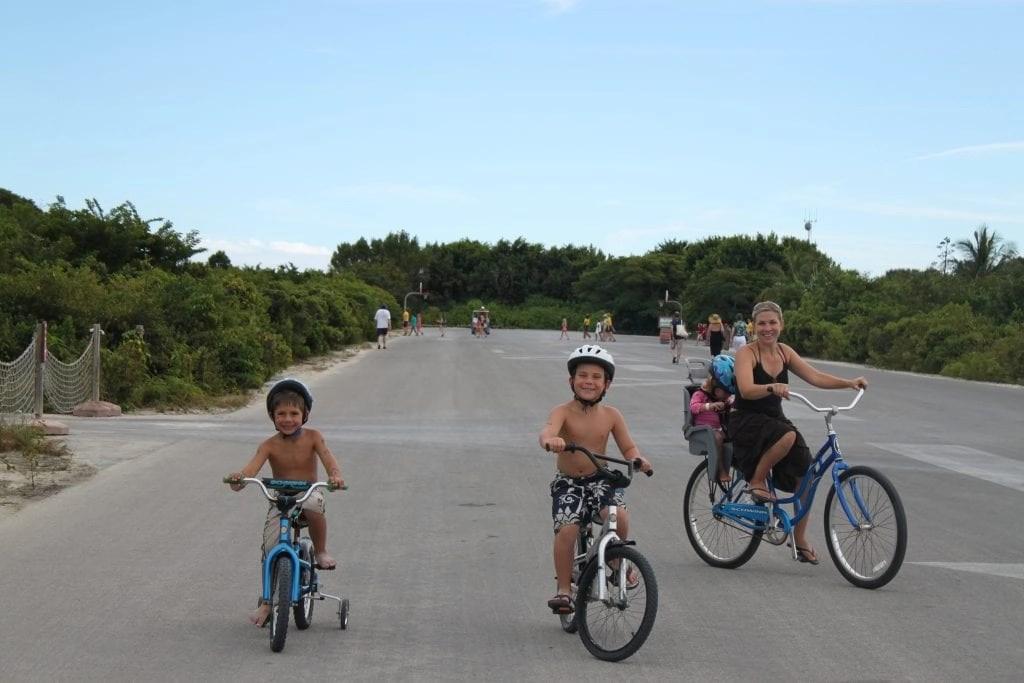 Family bike riding on Disney's Castaway cay | Global Munchkins