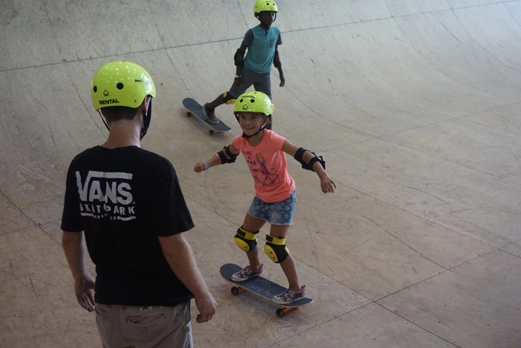 Little girl learning to skateboard at Vans Skatepark in Orange County | Global Munchkins