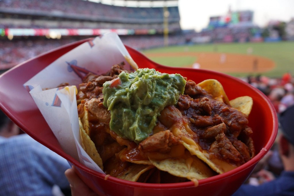 Delicious helmet nachos while watching a baseball game at the Anaheim Angels Stadium | Global Munchkins