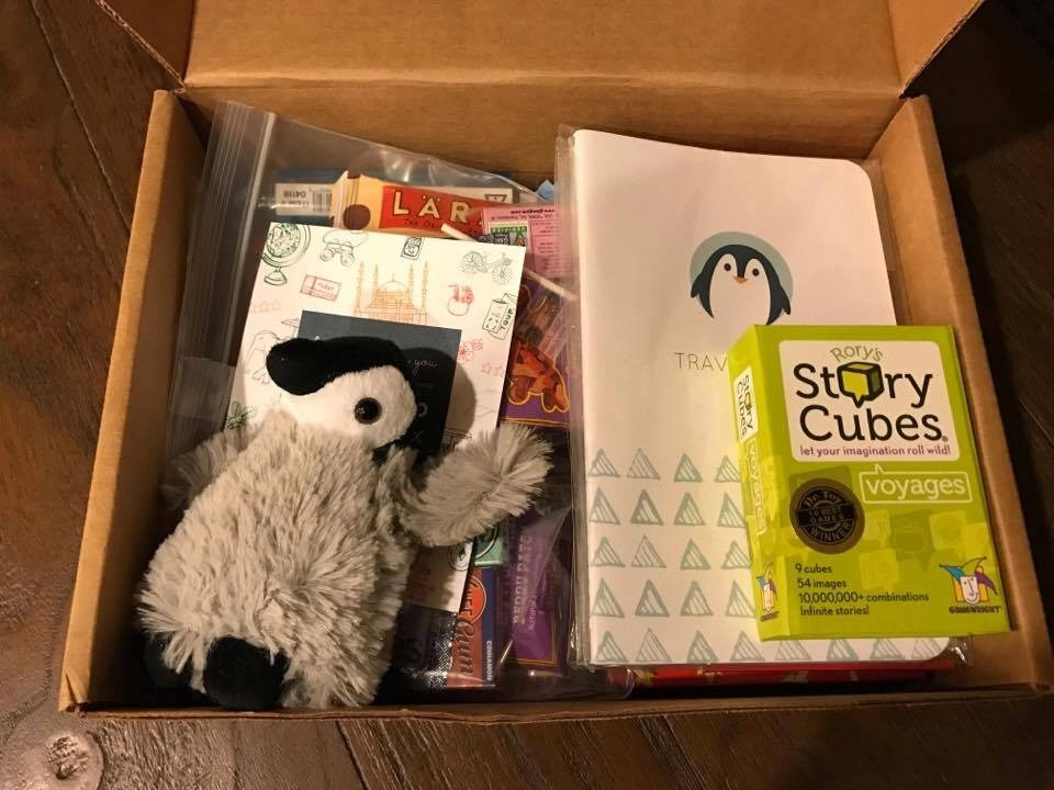 Check out all the awesome stuff that came in our Penguino Travel Kit. These kits are perfect for ordering right before a big trip. The travel kit is filled with snacks, treats, art supplies and games to keep your little one entertained on the flight.