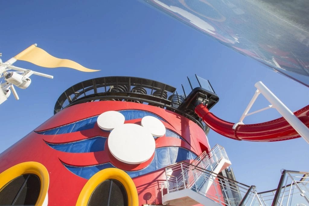 AquaDunk on the Disney Magic is a thrilling new three-story body slide that begins with a surprise launch when the floor beneath guests' feet opens like a trap door. The drop sends them on an exhilarating, swift and splashy ride in a translucent tube that extends 20 feet over the side of the ship. (Jimmy DeFlippo, photographer)