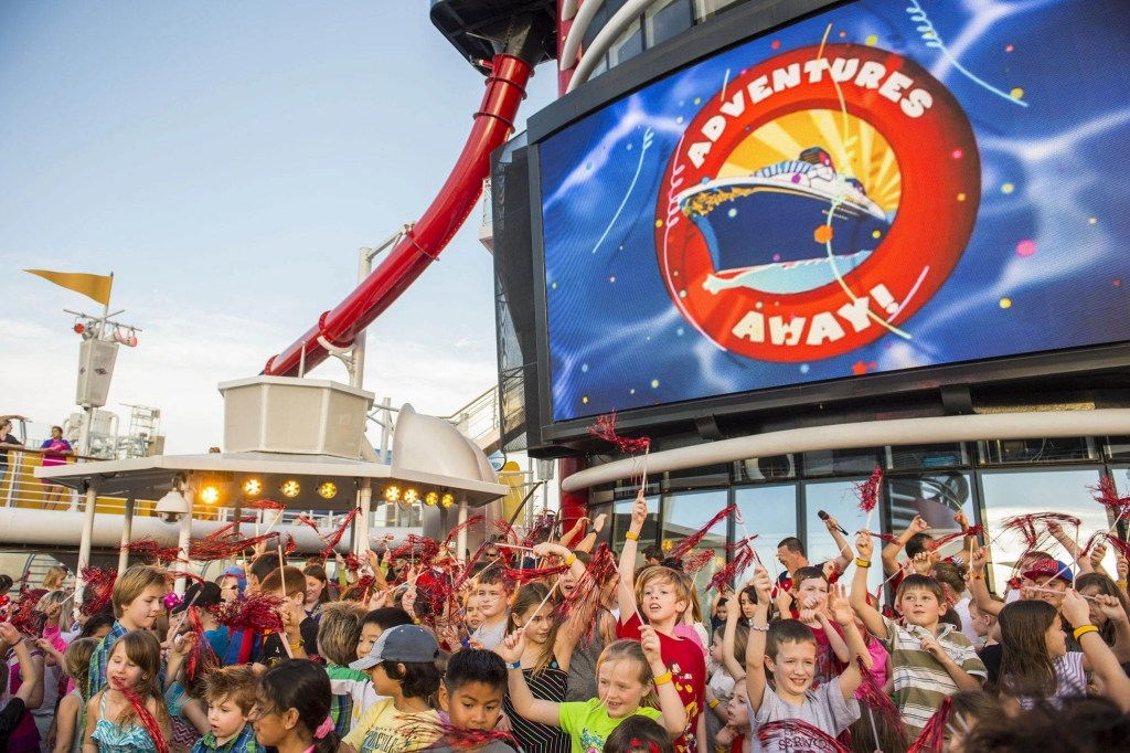 """""""Adventures Away,"""" an extra-special celebration on the upper decks, signals the official start of magical vacation on the Disney Magic. Deck parties aboard Disney Cruise Line are designed to entertain all ages with high-energy music, dancing, special effects and appearances by the Disney characters. (Matt Stroshane, photographer)"""