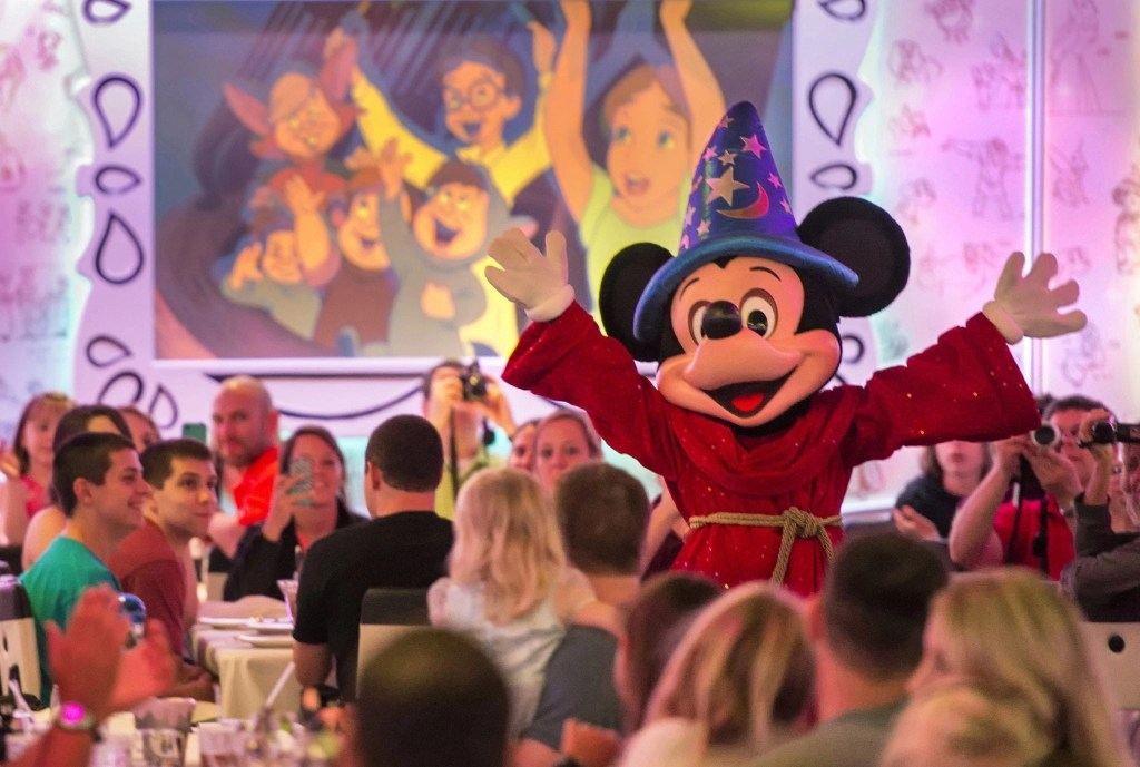 """The newly re-imagined Animator's Palate onboard the Disney Magic is now painting a refreshing new """"Drawn to Magic"""" show, immersing guests in an animated show about a hero's journey through Disney and Pixar animation from wishing upon a star to happily ever after. (Kent Phillips, photographer)"""