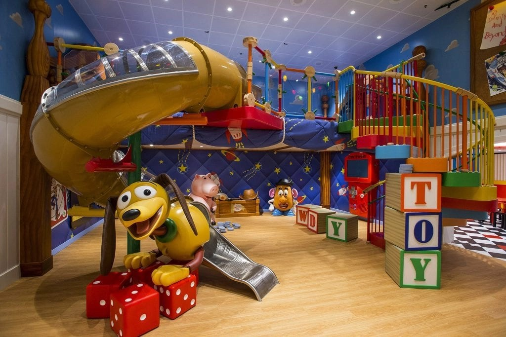 """Andy's Room, a new multi-level youth space in Disney's Oceaneer Club on the Disney Magic, brings the stars of the Disney-Pixar """"Toy Story"""" film trilogy to life. Stocked with all of Andy's favorite toys, the room features a giant, working Mr. Potato Head, larger-than-life version of the lovable """"Toy Story"""" piggy bank, Hamm, and Slinky Dog slide, the most fun way to descend to the toy room floor. (Matt Stroshane, photographer)"""