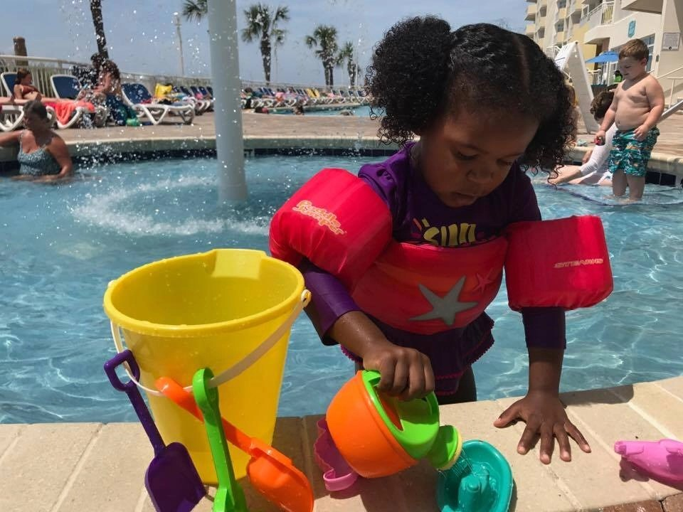 Liv playing at a pool at our Wyndham Vacation Rental
