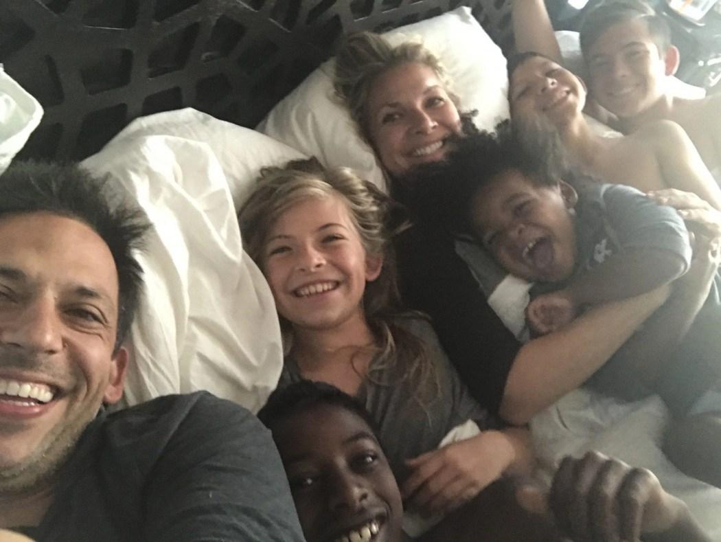 Multi Racial Adoptive Family in Bed