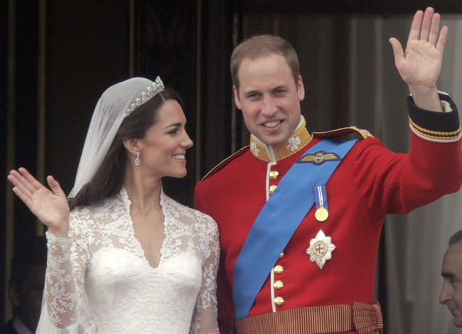 Britain's Prince William, right, and Kate, Duchess of Cambridge wave from the balcony of Buckingham Palace after their wedding service at Westminster Abbey in London, in this April, 29, 2011, file photo. THE CANADIAN PRESS/AP, Lefteris Pitarakis