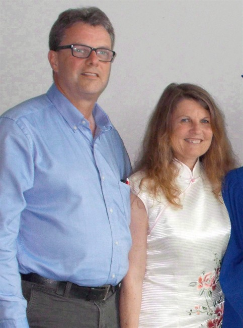 Kevin and Julia Garratt are shown in an undated photo. The Canadian couple say they were detained by China and interrogated for six hours every day.