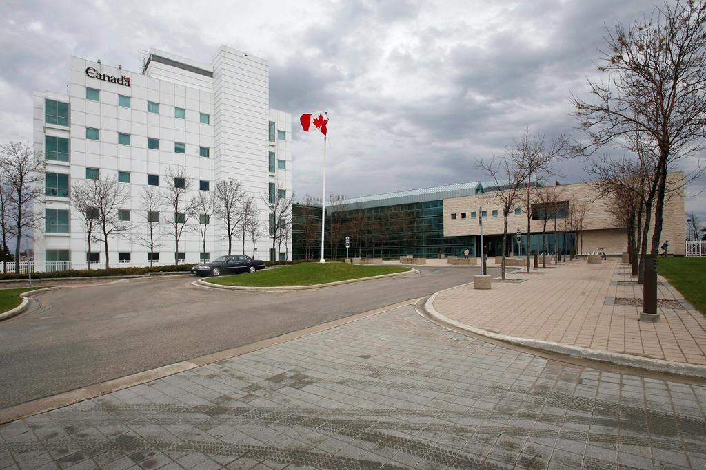 The National Microbiology Laboratory is shown in Winnipeg on May 19, 2009. The University of Manitoba has cut ties with a researcher who helped develop the Ebola vaccine while she is being investigated by the RCMP.A spokesperson says Dr. Xiangguo Qiu and her husband, Keding Cheng, have both had their non-salaried adjunct appointment at the university severed pending the investigation.THE CANADIAN PRESS/John Woods.