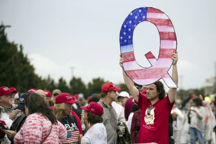 David Reinert holding a Q sign waits in line with others to participate in a campaign rally with President Donald Trump and U.S. Senate candidate, Republican Lou Barletta, R-Pa., Thursday, August 2, 2018, in Wilkes- Barre, Pennsylvania.