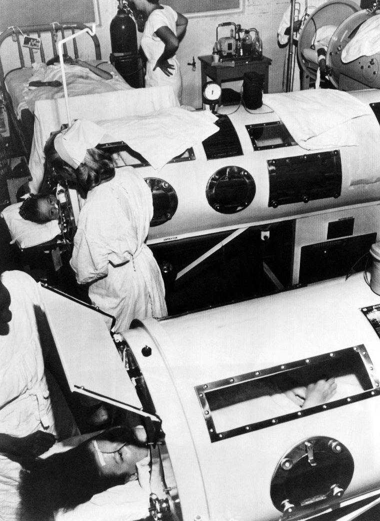 Polio patients being treated with iron lungs in a hospital ward, circa 1948. CSU Archives/Courtesy Everett Collection