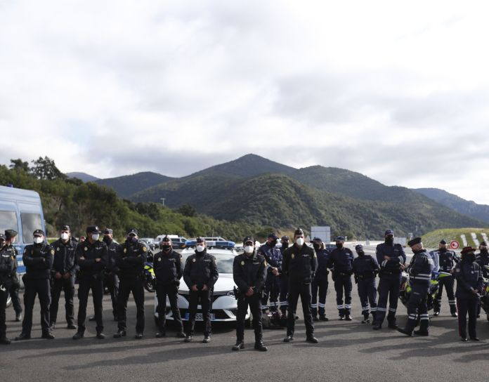Police officers attend the French President's visit to the border between France and Spain, during which he announced that the number of border guards would be doubled to 4,800 from 2,400