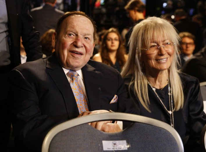 In this September.  File Photo 26, 2016, CEO of Las Vegas Sands Corporation Sheldon Adelson sits with his wife Miriam waiting for the presidential debate between Democratic presidential candidate Hillary Clinton and Republican presidential candidate Donald Trump at Hofstra University in Hempstead, New York
