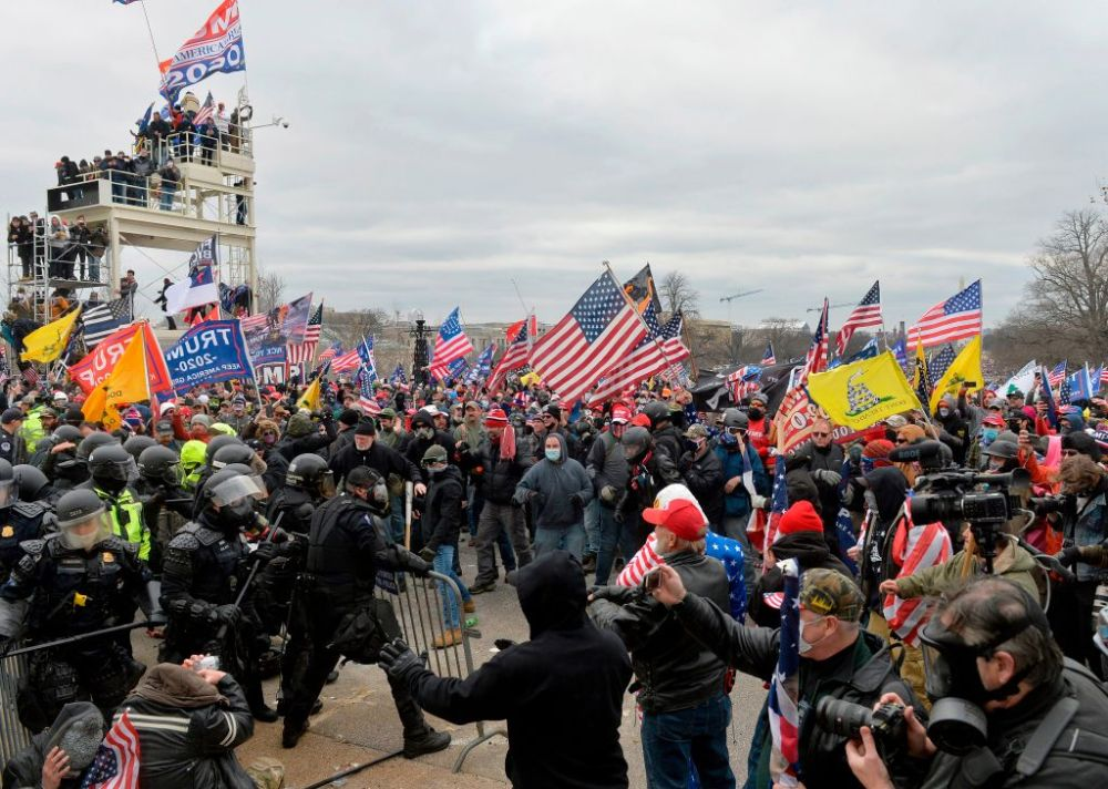 Trump supporters clash with police and security forces as they try to storm the U.S. Capitol in Washington, D.C. on January 6, 2021.