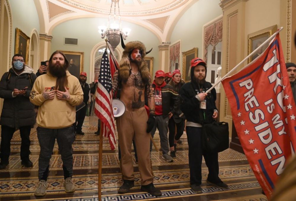 Supporters of U.S. President Donald Trump, including member of the QAnon conspiracy group Jake A, a.k.a. Yellowstone Wolf (centre), enter the U.S. Capitol on Jan. 6, 2021, in Washington, D.C.