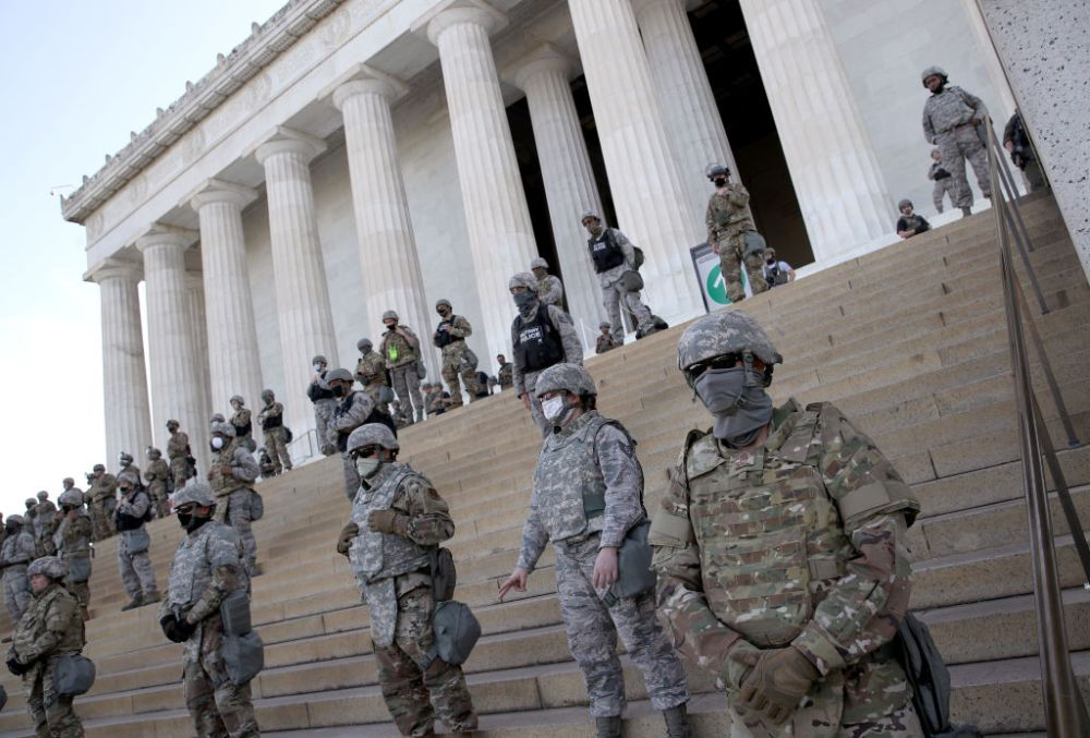 Members of the D.C. National Guard stand on the steps of the Lincoln Memorial as demonstrators participate in a peaceful protest against police brutality and the death of George Floyd, on June 2, 2020, in Washington, D.C.