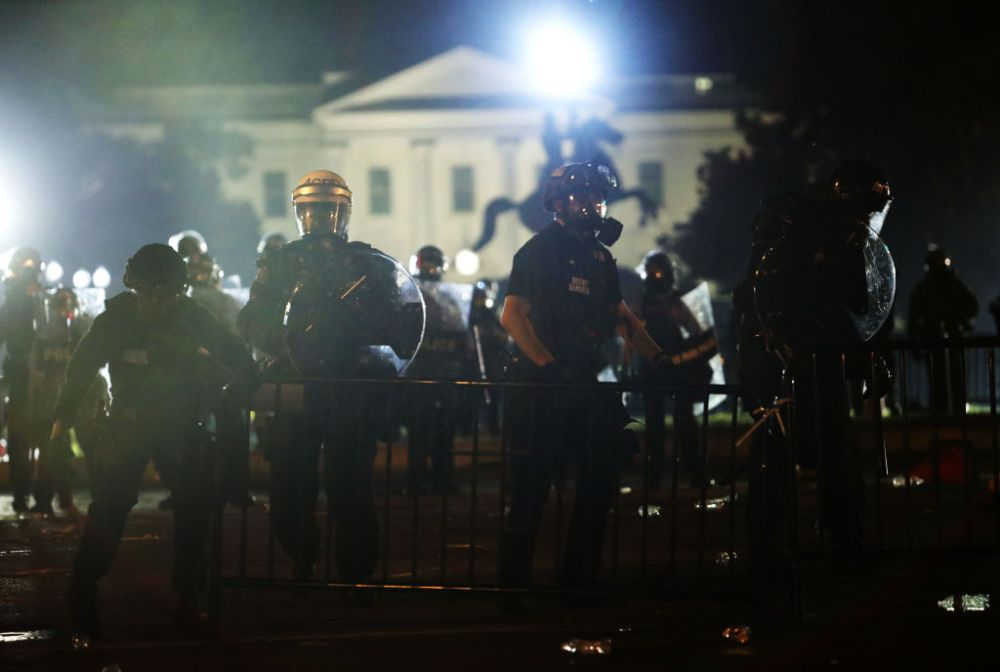 Police officers hold a perimeter during a protest near the White House in response to the killing of George Floyd on May 31, 2020, in Washington, D.C.