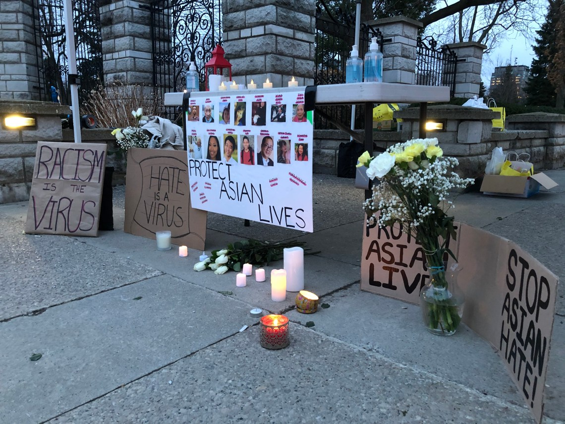 Candles are lit at a vigil dedicated to lives lost to anti-Asian racism during a rally in London, Ont.