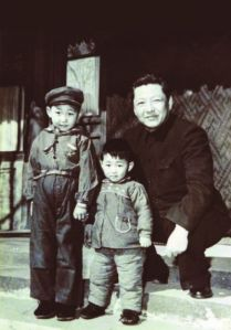 5-year-old Xi Jinping with his younger brother and their father in 1958.
