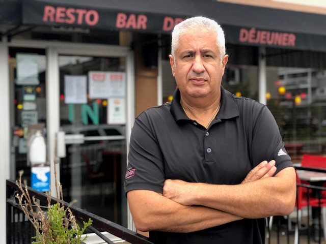 Restaurant owner Bill Mahfouz, pictured outside his restaurant Benny's All Day in Rockland, Ont., said his staff have faced abuse over Ontario's proof of vaccination rules.