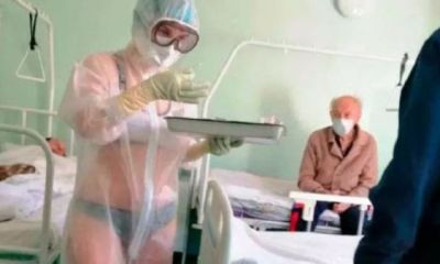 Amazing nurse wears only undies under transparent PPE while treating COVID-19 male patients