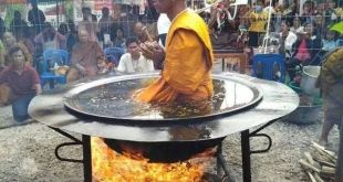 Monk meditates in pot of boiling oil